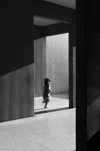 Child Running Below Building
