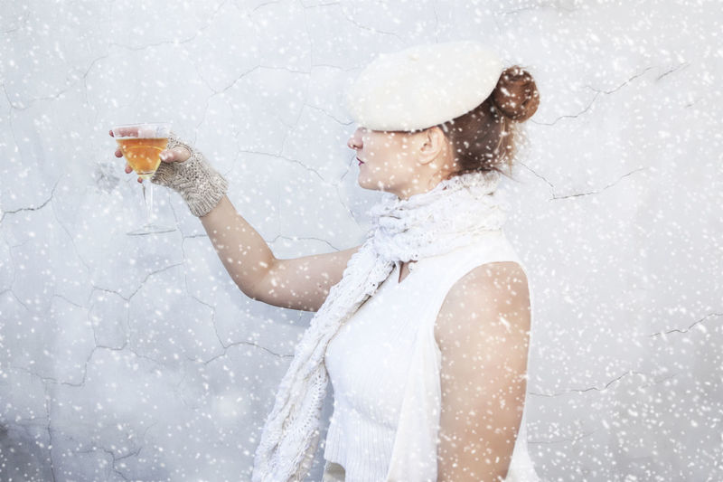Woman Holding Wineglass In The Snow