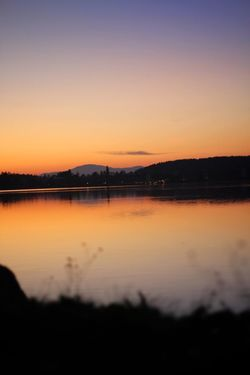 Klopeinersee, AUT Sunset Reflection Silhouette Beauty In Nature Nature Scenics Tranquility Orange Color Sky No People Copy Space Idyllic Water Lake Outdoors Mountain Clear Sky Tree EyeEmNewHere Colour Your Horizn