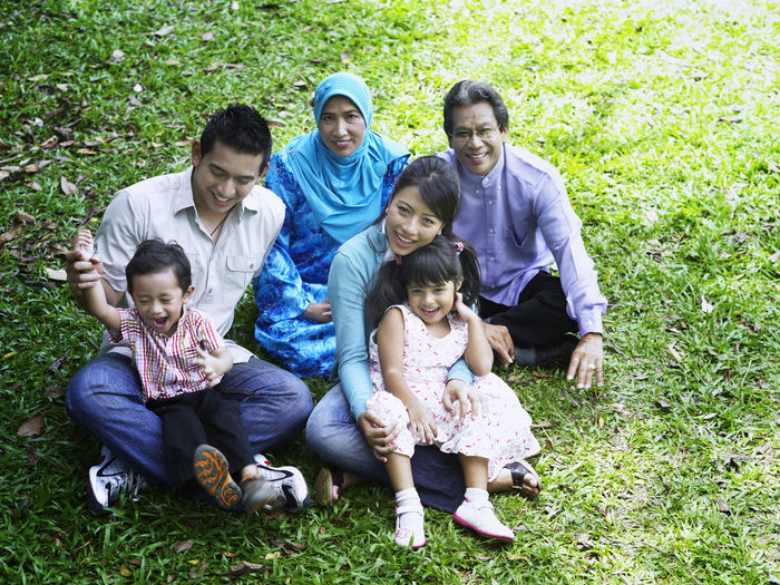 family spend time in the park Asian  Family Fun Grand Parents Grass Happiness Holiday Sitting Bonding Casual Clothing Cheerful Child Childhood Front Or Back Yard Group Of People High Angle View Leisure Activity Lifestyles Malay Parents Park - Man Made Space Portrait Senior Smiling Togetherness This Is Family