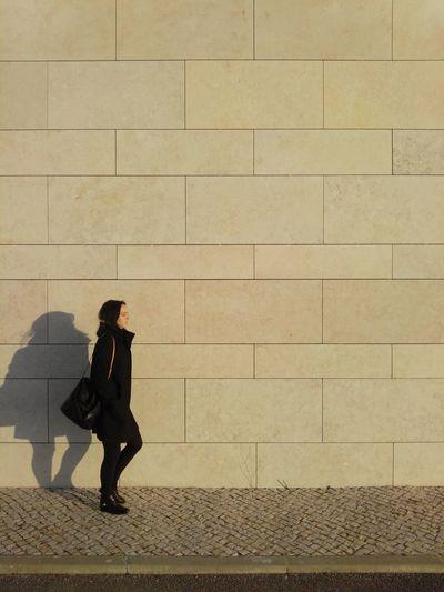 Walking Walking Alone... Walk People Walking  Wall Stone Wall Shadow Shadows Sunsetshadow Lights And Shadows
