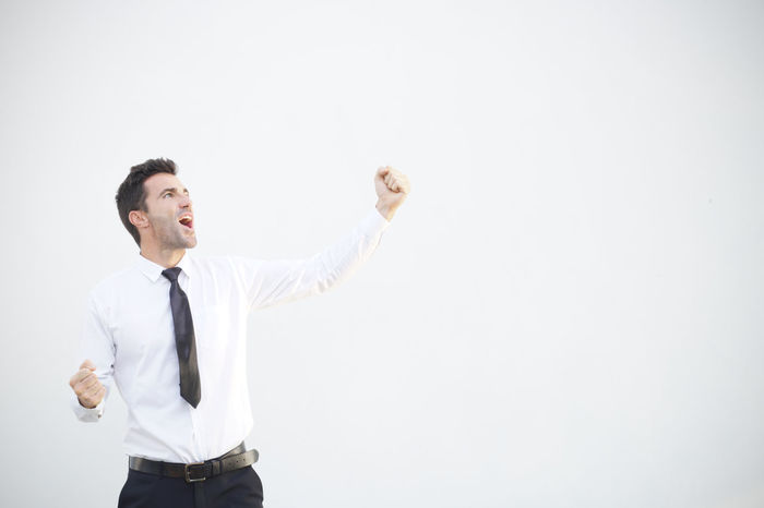 Young business man enjoying success with copy space for your texts – Stock Image Adult Bonus Business Celebration Copy Space Happy Man Modern Winning Backgrounds Businessman Cheerful Enjoying Life Human Body Part Light And Shadow person Portrait Scream Smiling Success Successful Suit And Tie White Young Adult Young Women