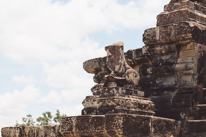Siem Reap Cambodia Angkor Architecture Built Structure Sky Religion Ancient Place Of Worship Cloud - Sky History Belief The Past Representation Spirituality Travel Destinations Art And Craft Travel No People Sculpture Tourism Ancient Civilization Outdoors Archaeology Ruined