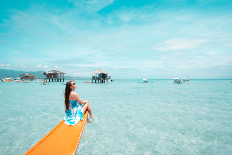 Chilling and refreshing Refreshment EyeEm Selects Philippines Water Sea Sky Vacations Beauty In Nature Leisure Activity Trip Lifestyles Holiday Nature Bikini Scenics - Nature Cloud - Sky Day Nautical Vessel Swimwear Adult One Person Real People Turquoise Colored Horizon Over Water Outdoors