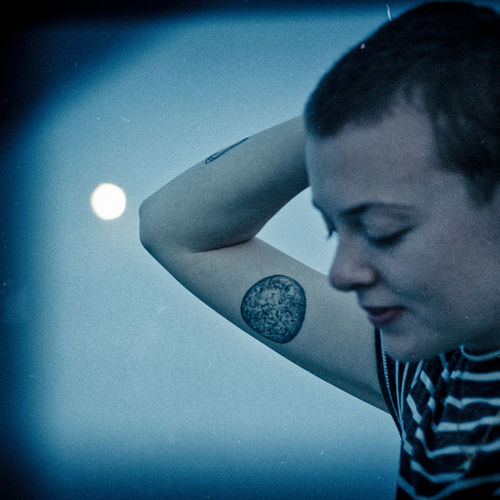 Arm Close-up Dusk Elbow Eyes Closed  Fullmoon Headshot Moon Night One Person Outdoors People Real People Shaved Head Short Hair Sky Tattoo Thinking Vintage Young Adult Young Women Discover Berlin Love Yourself The Portraitist - 2018 EyeEm Awards HUAWEI Photo Award: After Dark