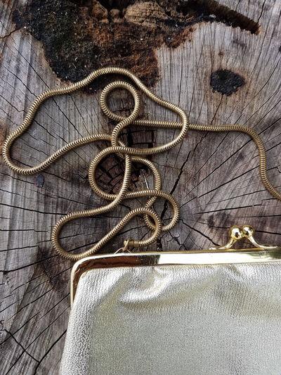 Golden Handbag Handbag  Golden Color Wooden Background Outdoors No People Day Close-up