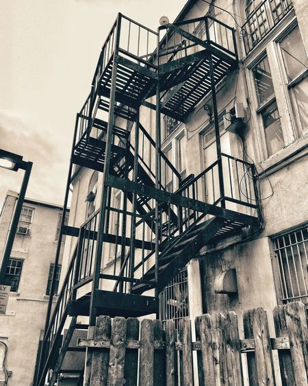 The great escape Architecture Building Exterior Built Structure Emergency Exit Fire Escape Low Angle View No People Outdoors Railing Safety Staircase Stairs Steps Steps And Staircases
