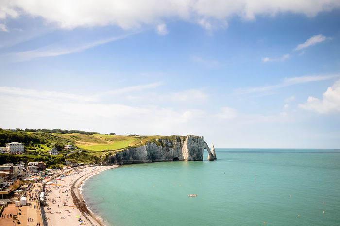 Cliffs of Etretat in a blue sky day of summer Beach Cliff Cliffs Coastline Horizon Horizon Over Water Landscape Nature Nature Normandy Ocean Rock Formation Rocks Scenics Sea Seascape Shore Sky Summer Summertime Tranquil Scene Tranquility Traveling Water étretat