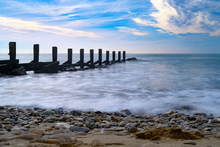 Sea Water Sky Horizon Horizon Over Water Beach Cloud - Sky Scenics - Nature Rock Motion Nature Solid Beauty In Nature Rock - Object Land Wave No People Tranquil Scene Post Wooden Post Outdoors Groyne Power In Nature