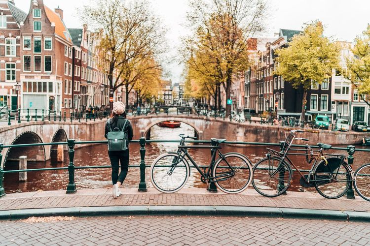 Architecture Bicycle Building Exterior Built Structure City Transportation Mode Of Transportation City Life Railing Land Vehicle Nature Canal Day Tree Autumn Full Length Street Plant Bridge People Bridge - Man Made Structure Outdoors Change Amsterdam