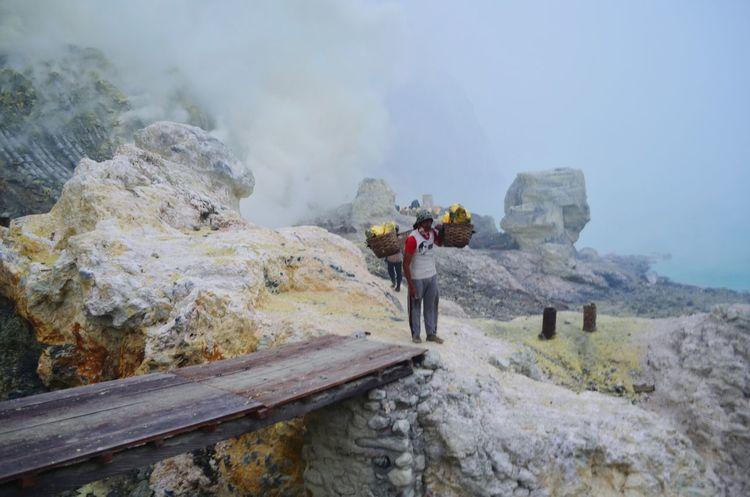 Sulphur miners working inside the Ijen crater Mining Sulphur Toxic Mount Ijen Ijen Kawah Ijen INDONESIA Backpacking