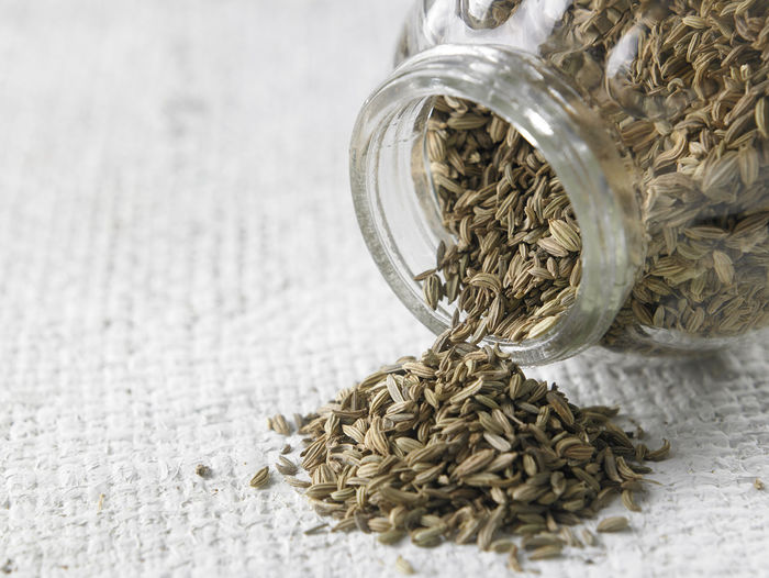 Close-up of cumin seeds in jar on table
