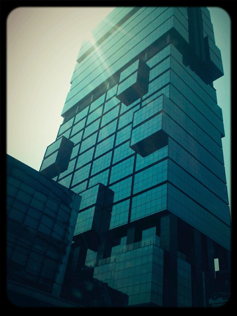 architecture, building exterior, built structure, auto post production filter, low angle view, modern, skyscraper, outdoors, window, day, no people, city, tall, sky, office park