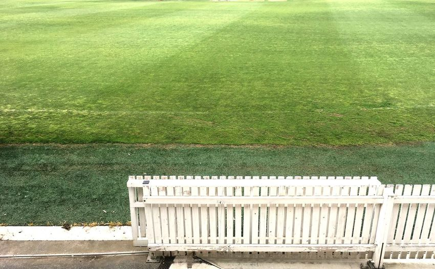 Grass Day No People Green Color Outdoors Nature Sports Ground Cricket Field White Fence Sport Football Field Grounds Cricket Lawn