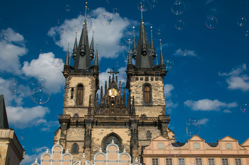 Soap bubbles in the old town Staromestska square in Prague, background of Church Of Our Lady Before Tyn Beautiful Bohemia Church Church Of Our Lady Before Tyn City Cross Czech Republic Famous Gothic Old Town Prague Spirituality Travel Worship Architecture Building History No People Religion Sky Tourism Tower Travel Travel Destinations Urban