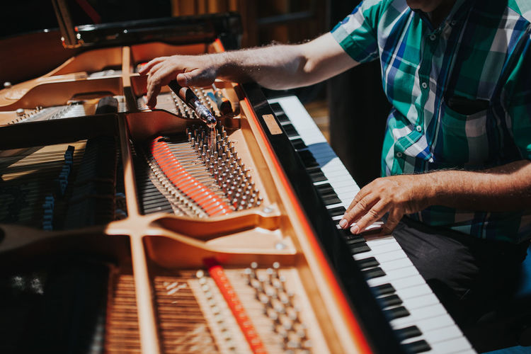 Piano Piano Moments Piano Tuner Repairs Arts Culture And Entertainment Finger Indoors  Keyboard Keyboard Instrument Men Midsection Music Musical Equipment Musical Instrument Musician One Person Piano Piano Key Piano Keys Piano Repair Piano Tuning Playing Repairman Skill