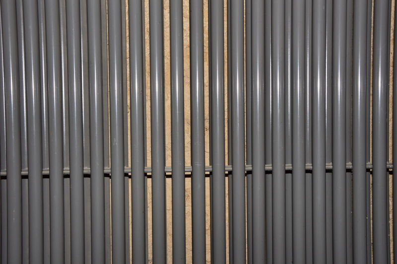 Zoom on a large water radiator Heater Zoom On A Large Water Radiator Heating Element Iron Metal Metal Structure No People Pattern Radiator Side By Side Warmth Water Radiator