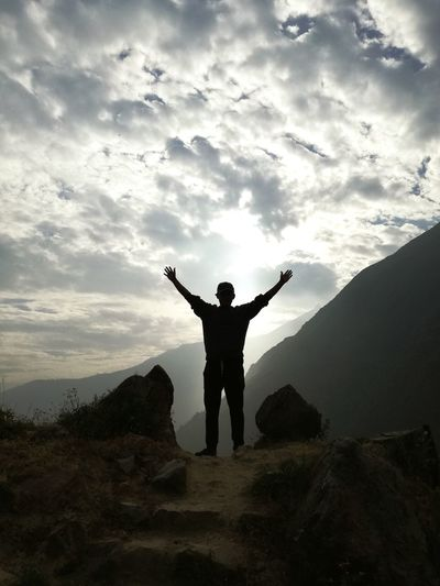 EyeEmNewHere Human Arm Arms Outstretched Arms Raised Standing Silhouette One Man Only Full Length One Person Only Men Travel Artistic Nature Outdoors Mountain Men Landscape Mountain Range Travel Destinations Sunset Sunset_collection Nature Photography Travel Photography Cloud - Sky Happiness