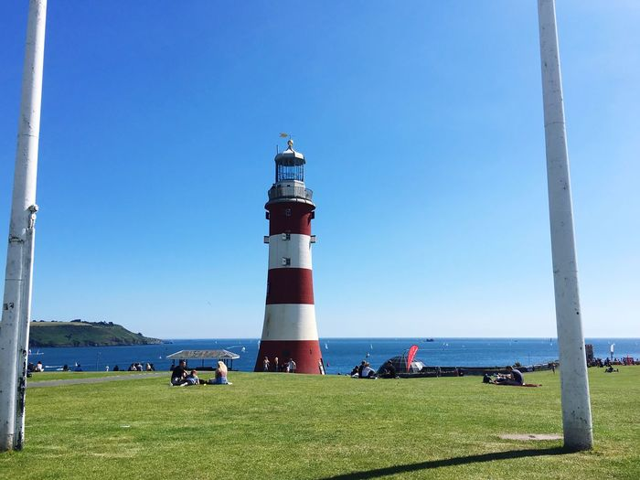 Plymouth hoe Lighthouse Grass Sea Water Built Structure Nautical Architecture Outdoors City Guidance Safety Clear Sky Blue People City Life Park Landscape Plymouth England EyeEm Best Shots EyeEm Eyeemphotography