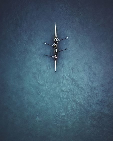 Aerial View Of People Rowing Boat At Sea