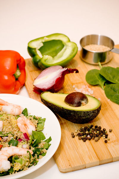 Avacado Chopping Board Close-up Composition Food Food And Drink Food Preparation Freshness Green Color Healthy Eating Healthy Lifestyle Leaf Organic Pepper Peppercorns Peppers Prawns Preparation  Quinoa Red Onions Spinach Vegetable