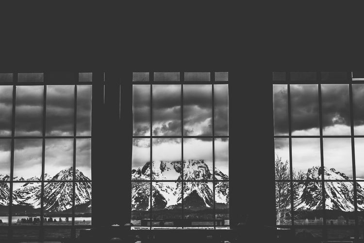 The Grand Tetons Grand Teton National Park  Grand Teton National Park, Wyoming Grand Tetons Architecture Black And White Black And White Photography Built Structure Cloud - Sky Indoors  Mountain Range Nature No People Sky Window EyeEmNewHere