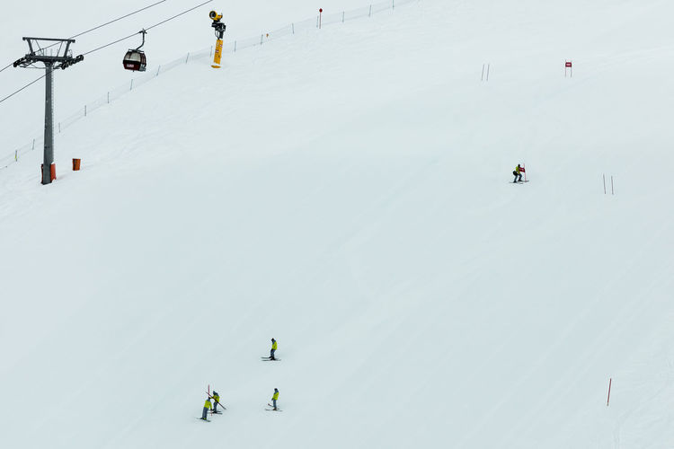 High angle view of people skiing in snow