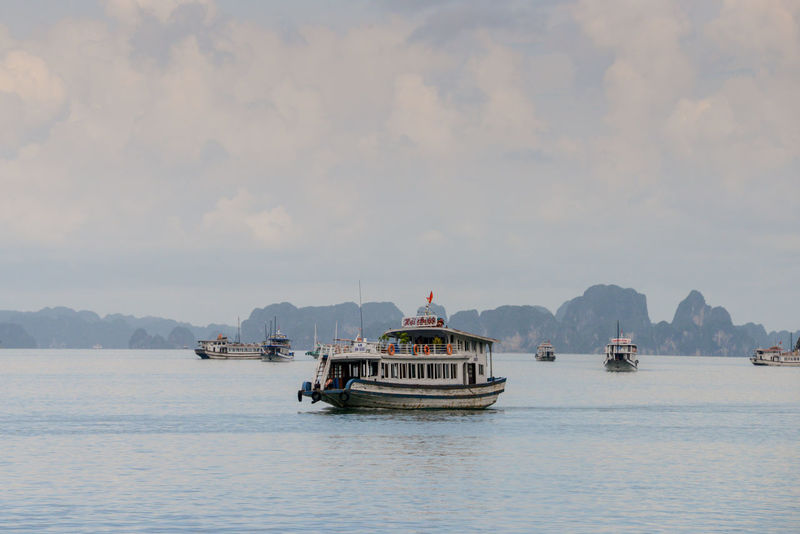 Halong Bay Vietnam Halong Bay Vietnam Halong Bay  Halongbay Vietnam Beauty In Nature Day Mode Of Transport Mountain Nature Nautical Vessel No People Outdoors Sailing Scenics Sea Sky Transportation Travel Destinations Vietnam Travel Vietnam Trip Vietnamphotography Vietnamtravel Water Waterfront