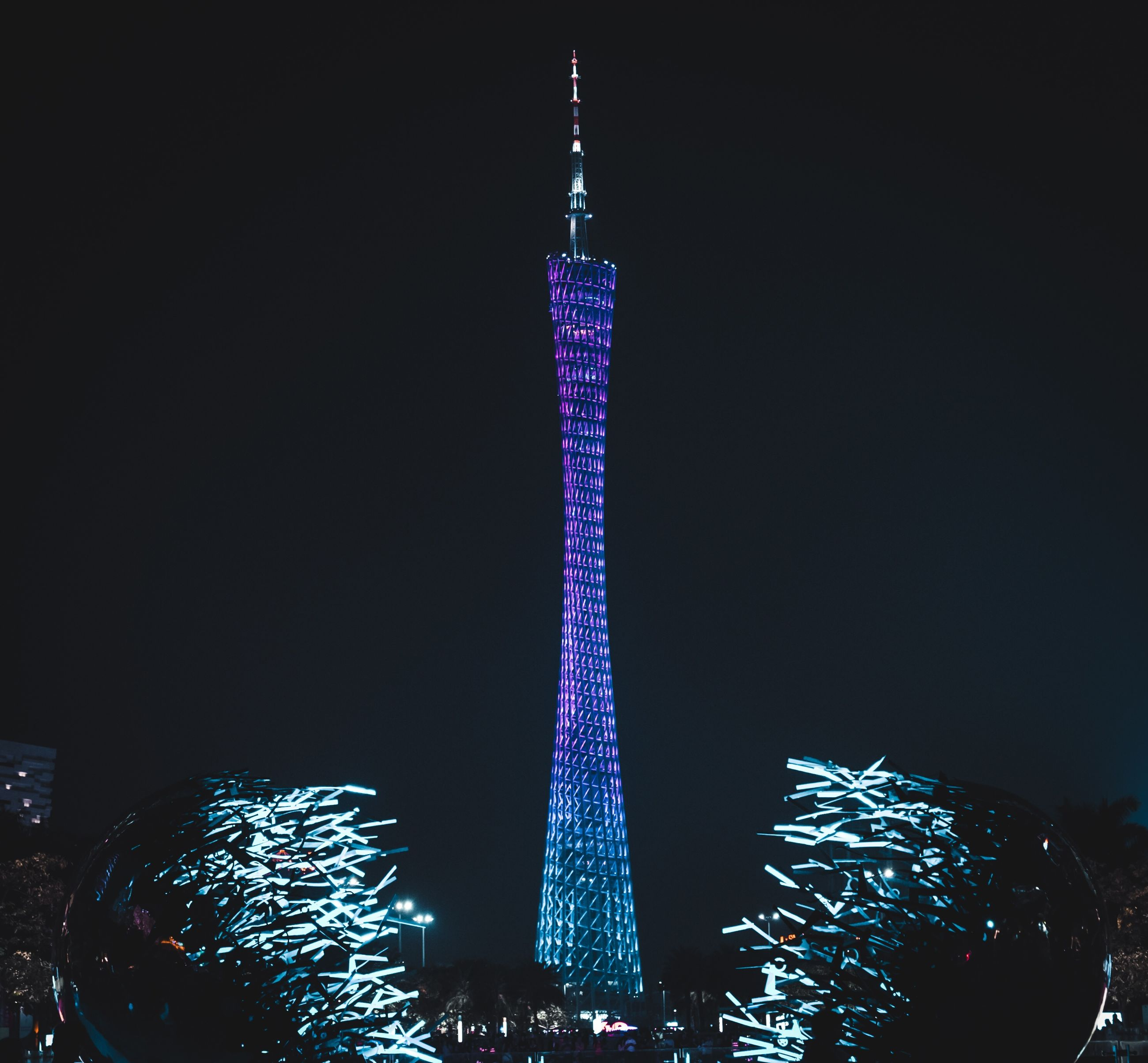 night, illuminated, architecture, tall - high, built structure, travel destinations, travel, sky, tower, city, tourism, celebration, decoration, copy space, no people, nature, holiday, building exterior, christmas tree, christmas, outdoors, skyscraper, purple, office building exterior, christmas ornament