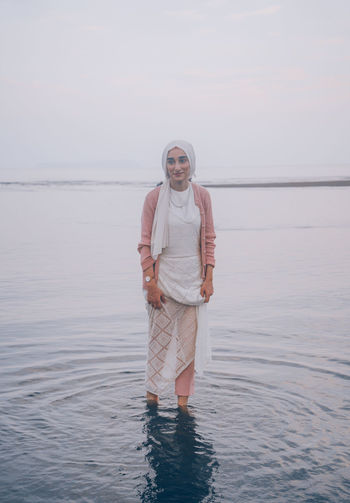 // whatever you're, be a good one // Japan Muslim Religious  Scarf Model EyeEm EyeEm Selects Portrait Portrait Of A Woman Past Pastel Pastel Colored Tones AMPt_community Shootermag Water Real People Standing One Person Lifestyles Leisure Activity Beauty In Nature Front View Sea Scenics - Nature Looking At Camera Waterfront Nature Young Adult Casual Clothing Day Sky Outdoors Smile Smiling