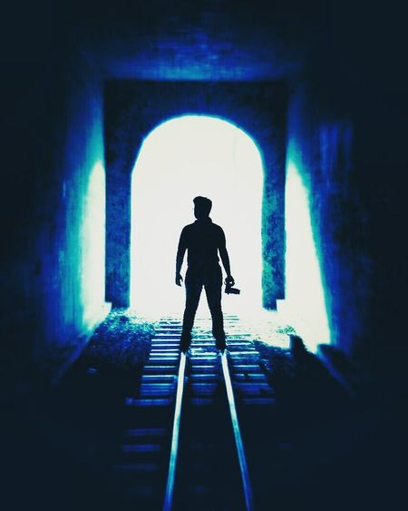 The Magic Mission Silhouette Light At The End Of Tunnel Archway The Way Forward Silhouette Full Length Standing Men Indoors  Arch Rear View Entrance Tunnel Light At The End Of Tunnel Archway Day The Way Forward Blue