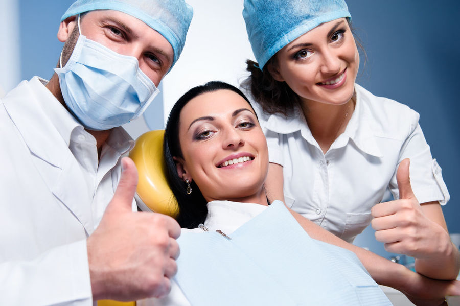 Friendly male dentist with assistant and smiling patient showing thumb up Dental Dentist Dentistry Man Medicine Nurse Office Uniform Work Attractive Caucasian Dental Clinic Friendly Healthcare And Medicine Indoors  Medical Occupation Orthodontic Orthodontist  Patient Procedure Professional Occupation Teeth Thumbs Up Tooth