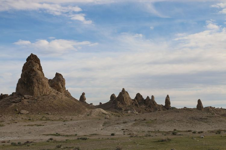 Underwater formations in dried up lake Desert Pinnacles Rock Formations Beauty In Nature Cloud - Sky Day Dried Up Lake Geology Landscape Mountain Mountains Nature No People Outdoors Scenics Sky Sunlight And Shadow Tranquil Scene Tranquility Trona Pinnacles