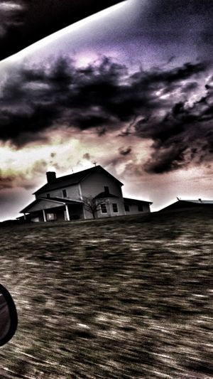 House against dramatic sky