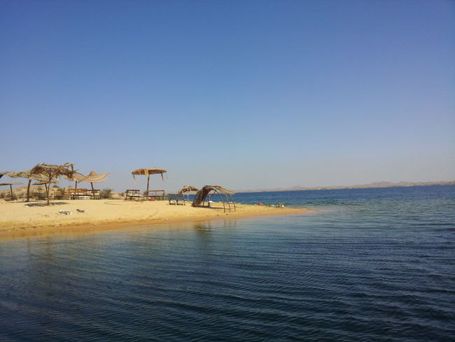 Beauty In Nature Blue Clear Sky Day Horizon Over Water Idyllic Leisure Activity Lifestyles Nature Non-urban Scene Outdoors Remote Scenics Sea Shore Sky Tranquil Scene Tranquility Travel Destinations Vacations Water Lake Nasser Egypt Aswan Showcase June