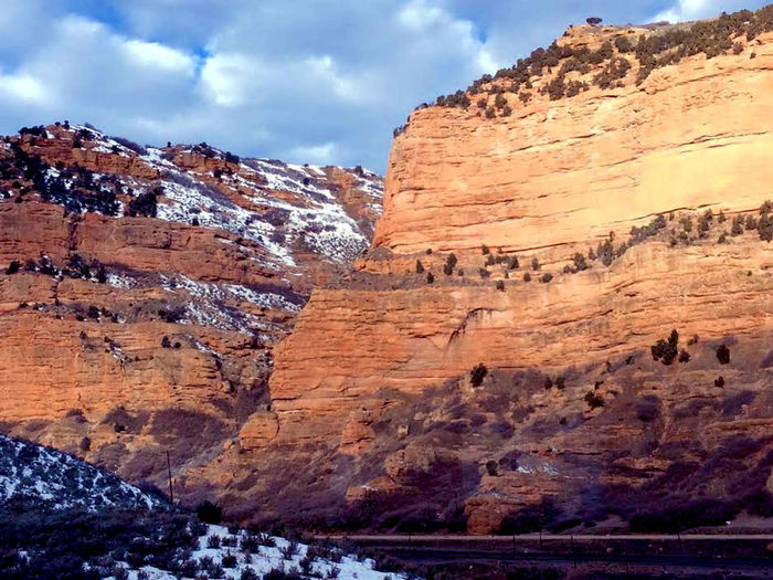 One of the scenery from Utah. Beauty In Nature Cliff Cloud - Sky Day Geology Landscape Mountain Mountain Range Multi Colored Nature No People Outdoors Physical Geography Rock - Object Rock Formation Rock Hoodoo Scenics Sky Snow Travel Destinations
