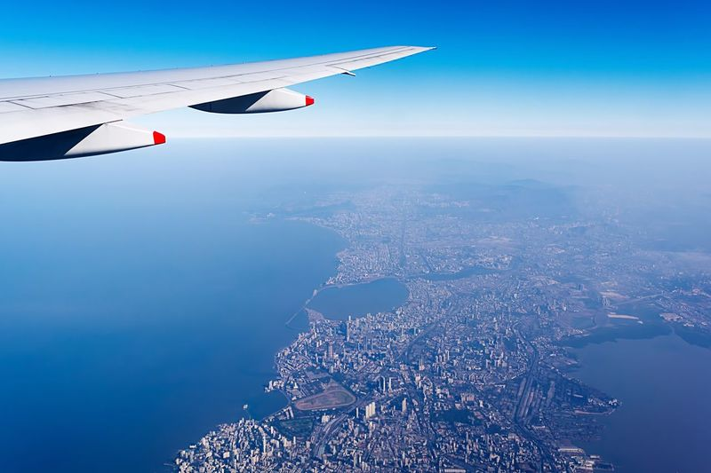 Cropped Image Of Aircraft Wing Over Sea