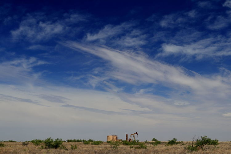 Permian Basin oil production under a big West Texas Sky Natural Resources Industry Oilfield Permian Basin Midland, TX Storage Tank Pump Jack West Texas Skies Texas Landscape Petroleum Industry