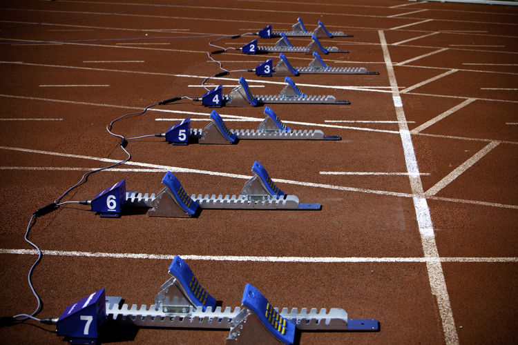 Starting blocks in row on race track