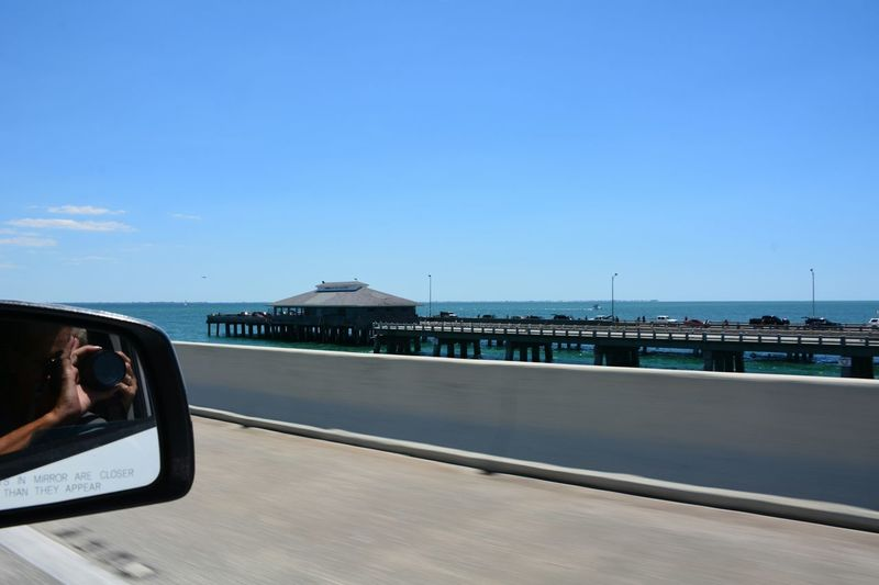 Sunshine Skyway Fishing Pier, view from the passenger side riding over the Sunshine Skyway Bridge (I-275) Tampa Bay area Florida Sunshine Skyway Bridge Over The Bridge Transportation Bridge - Man Made Structure Architecture Passenger View Side View Mirror Clear Sky Blue Sky Driving Vehicle Mirror Side-view Mirror Horizon Over Water Scenics Passenger Side View Roadtrip Tampa Bay Highway Recreational Pursuit Fishing Pier