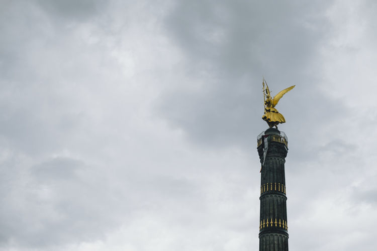 Siegessäule  Siegessäule Berlin Angel Architectural Column Architecture Cloud - Sky Gold Colored Low Angle View Memorial No People Sculpture Sky Statue Tall - High Tourism Travel Travel Destinations