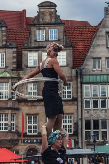 Full length of woman against buildings in city