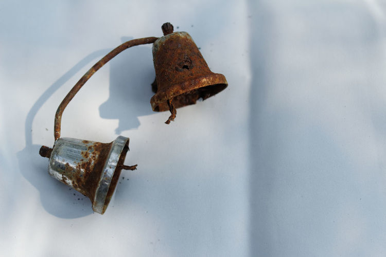 Close-up of abandoned lamp on wall