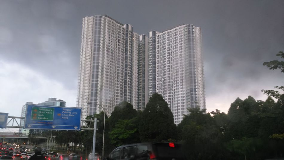 Sky scraper surrounding with trees and look at the rood in a rainy day, this is malaysia City Skyscraper Urban Skyline Cloud - Sky Sky Tree Outdoors Downtown District Cityscape Capture The Moment Malaysia Sony Xperia Welcome Weekly. The Week On EyeEem EyeEm Best Shots EyeEm Gallery Adapted To The City EyeEmNewHere Welcome Weekly