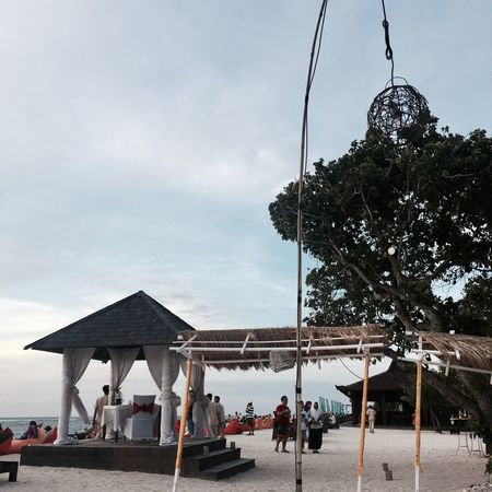 Beach party preparations Popular Photos Photography Like Followme Sky Nature Water Cloud - Sky Architecture Group Of People Real People Built Structure Beach Incidental People Day Land Plant Crowd Holiday Tree Outdoors