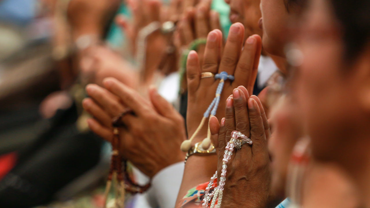 People Praying At Temple