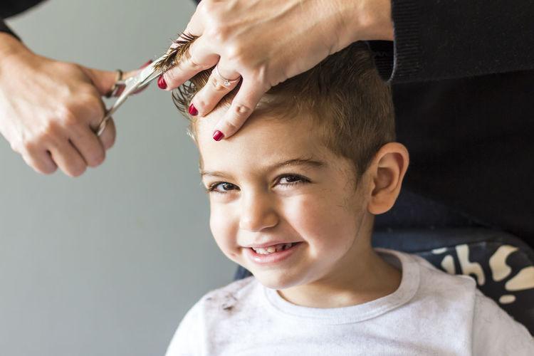 Portrait of boy having haircut