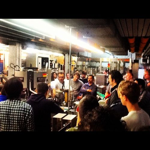 Fall 2012 Diploma class learning about the labeling process on the Doemen's bottling line. Brewing Doemens Germany Bavaria beer