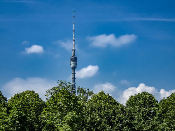 The Ostankino Tower is a television and radio transmitter in Moscow, Russia City Cityscape Moscow Ostankino Television Tower Ostankino Tower Ostankinotvtower Russia Trees Architecture Blue Building Exterior Built Structure Cloud - Sky Day Global Communications Low Angle View No People Outdoors Sky Spire  Summer Tall - High Tower Transmitter Transmitter Tower