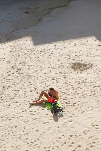 High angle view of boy on beach